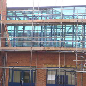 Curtain walling being added in a school by V&R